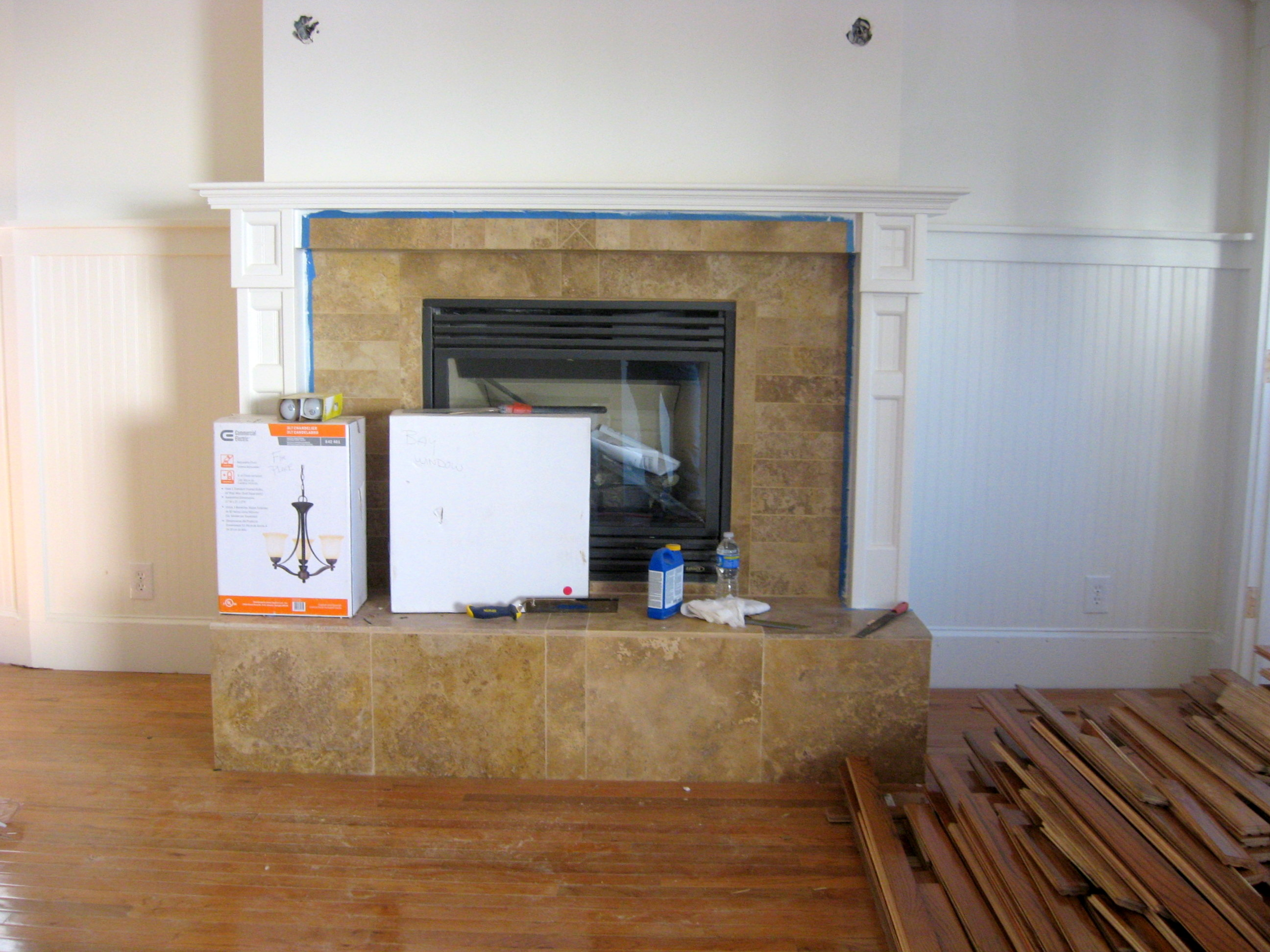 New oak wood flooring mantle for fireplace mark ingham for Wood floor up to fireplace